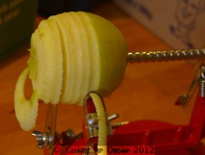 Peeling, coring and slicing apples.