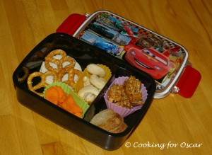Snack Box with pretzels, dried fruit, cashews, carrot shapes, biscuits and cereal bites.