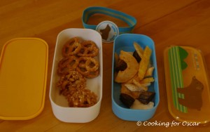 Snack Box with pretzels, cereal bites and dried fruit.